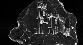Castillos microscópicos en un grano de arena, de Vik Muniz